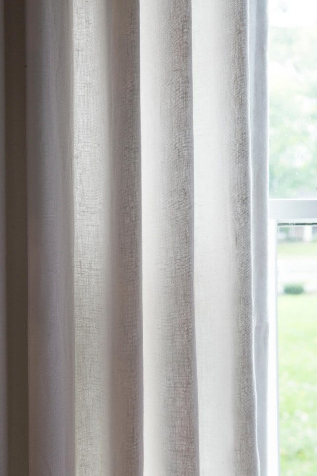 Close up of white pleated drapes