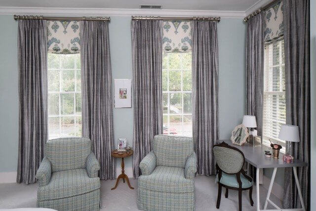 Silvery silk drapes with damask shades