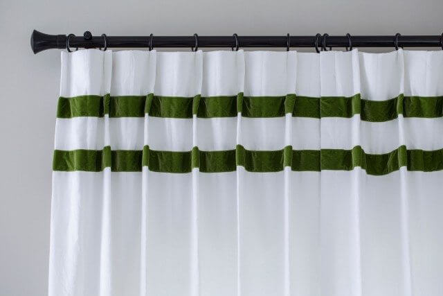 White curtain with double green trim