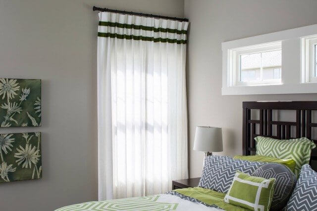 White curtain with green trim