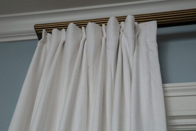 White pleated drapes close up