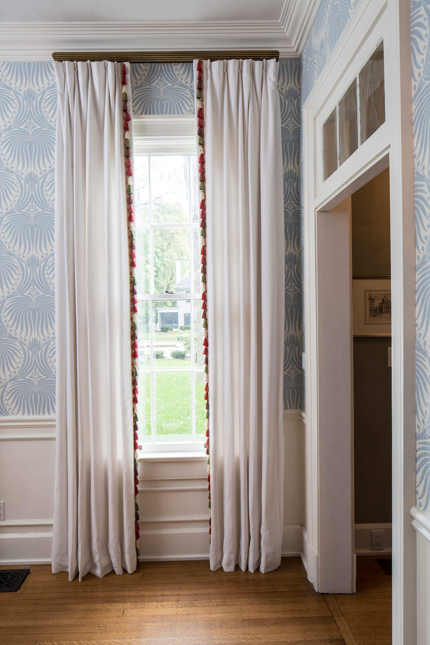White Pleated Drapes With Pom Poms