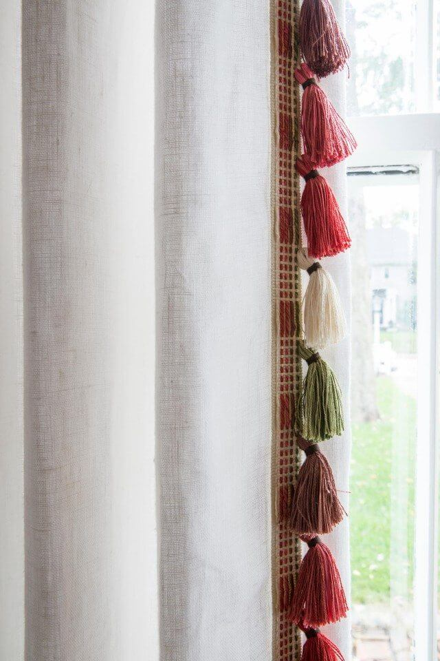 White pleated drapes with trim