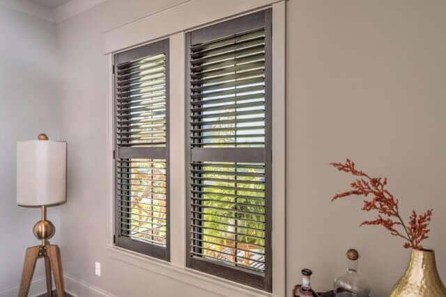 Hunter Douglas Heritance® hardwood shutters in espresso mounted inside the window
